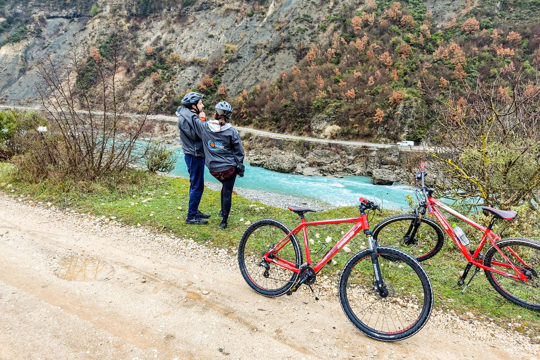 Biking along Vjosa River - go as local